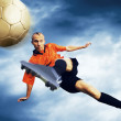 Shoot of football player on the sky with clouds — Lizenzfreies Foto