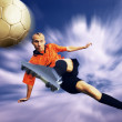 Shoot of football player on the sky with clouds — Stock Photo