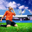 Happiness football player after goal on the field of stadium und — Stock Photo #6353028