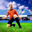 Happiness football player after goal on the field of stadium und — Stock Photo #6353033