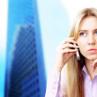 Happiness businesswoman calling by phone on the business archite — Stock Photo