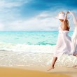 Young beautiful women in the white on the sunny tropical beach — Stock Photo #6353136