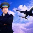 Pilot and airplane in the sky — Stock Photo #6353233