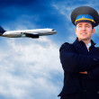 Stock Photo: pilot and airplane in the sky