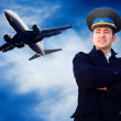 Pilot and airplane in the sky — Stock Photo #6353240