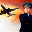 Pilot and airplane in the sky — Stock Photo #6353244