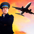 Pilot and airplane in the sky — Stock Photo #6353249