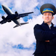 Pilot and airplane in the sky — Stock Photo