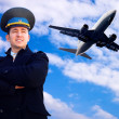 Stock Photo: Pilot and airplane in sky