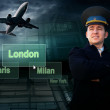 Pilot and airports citys on the button and plane — Stock Photo