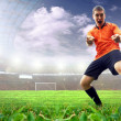 Happiness football player after goal on the stadium with light — Stock Photo #6353264