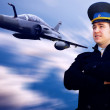 Pilot and military airplan on the speed — Stock Photo #6353369