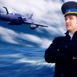 Stock Photo: Pilot and military airplon speed