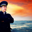 Capitan on the sea with ship — Foto de Stock