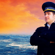 Capitan on the sea with ship — Stock Photo #6353406