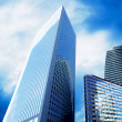 Stock Photo: Modern office Skyscrapers on sunny beautiful sky