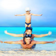 Royalty-Free Stock Photo: Happy young couple and son with snorkelling on a sea beach