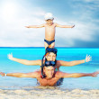 Happy young couple and son with snorkelling on a sea beach - Stock Photo