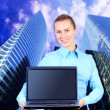 Happiness businesswoman with laptop on blur business architectur — Stock Photo #6353482