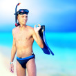 Portrait of happy young man with snorkelling on a sea beach — Stock Photo