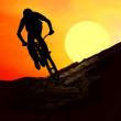 Silhouette of a man on muontain-bike, sunset — Stock Photo #6353545