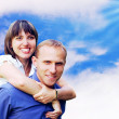 Young love couple smiling under blue sky — Stock Photo #6353786