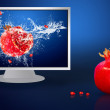 Fresh fruits in water on lcd monitor — Stockfoto