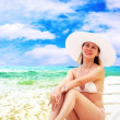 Young beautiful women on the sunny tropical beach in white bikin — Foto Stock