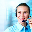 Happiness businesswoman speak in headphones on blur business arc — Foto Stock