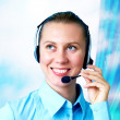 Happiness businesswoman speak in headphones on blur business arc — Stock Photo
