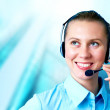 Happiness businesswoman speak in headphones on blur business arc — Foto de Stock