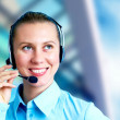 Stock Photo: Happiness businesswomspeak in headphones on blur business arc