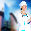 Smiling medical doctor with stethoscope on the hospitals backgro — Foto de Stock