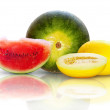 Beautiful isolated watermelon and yellow melon on white backgrou — Stok fotoğraf