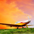 Airplane on sunset sky — Stock Photo