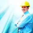 Young architect wearing a protective helmet standing on the buil — Stock Photo