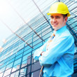Young architect wearing a protective helmet standing on the buil — Stock Photo #6354227