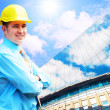 Young architect wearing a protective helmet standing on the buil — Stock Photo #6354228