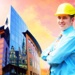 Young architect wearing a protective helmet standing on the buil — Stock Photo #6354230