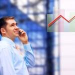 Businessman on architecture background — Stock Photo