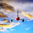 Airplane at fly on the sky with clouds — Stock Photo #6354253