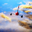 Airplane at fly on the sky with clouds - Foto de Stock