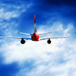 Airplane at fly on the sky with clouds — Foto Stock