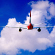 Stock Photo: Airplane at fly on sky with clouds