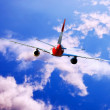 Airplane at fly on the sky with clouds — ストック写真