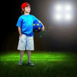 Happiness young boy on the field of stadium with light - Stock Photo