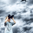 Young boy watch in the field-glass under sky — Stock Photo #6354405