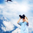 Young boy watch in the field-glass under sky — Stock Photo
