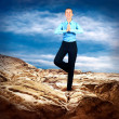 Happy Businesswoman standing in relaxing pose on the mountain un - Stock Photo