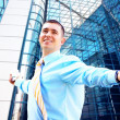 Hapiness Businessman standing on the business background — Foto Stock